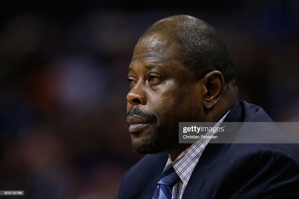 Associate coach Patrick Ewing of the Charlotte Hornets watches from the bench during the second half of the NBA game against the Phoenix Suns at...