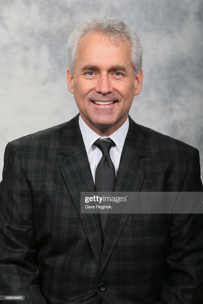 Associate Coach Tom Renney of the Detroit Red Wings poses for his official headshot for the 2012-2013 season at Compuware Ice Arena on January 13, 2013 in Plymouth, Michigan.
