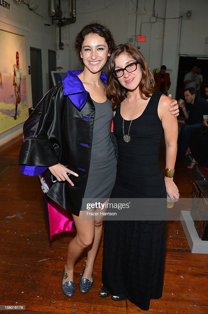 Associate Director of Exhibitions Ananda DeMello and Loren Santiesteban attend the Art Miami after party at Bakehouse Art Complex on December 8, 2012 in Miami, Florida.