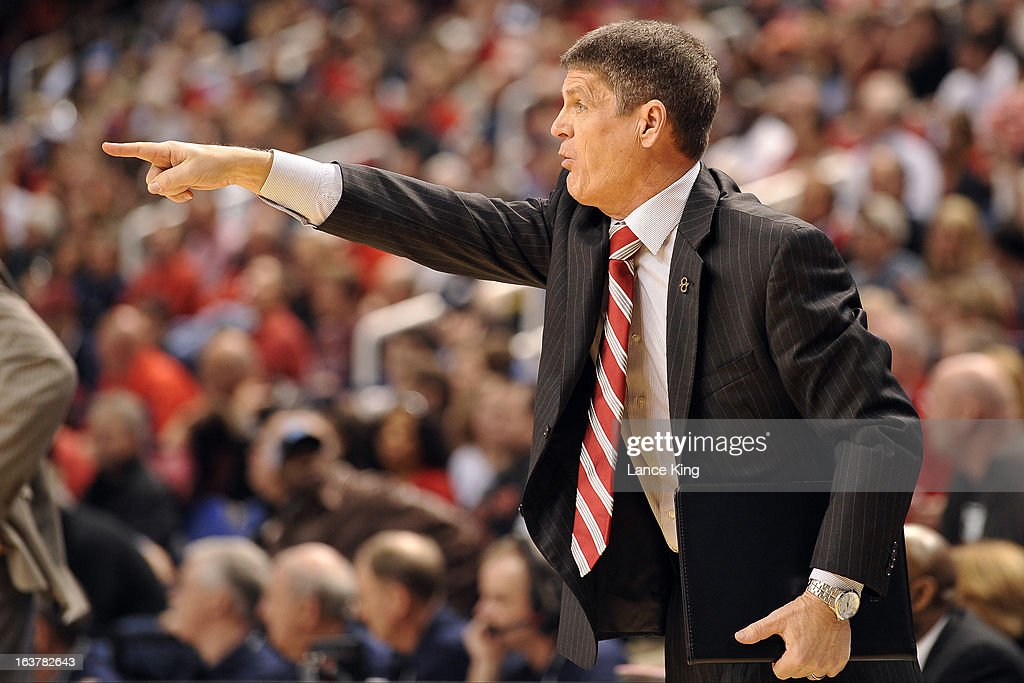 Associate Head Coach Bobby Lutz of the North Carolina State Wolfpack signals instructions during a game against the Virginia Tech Hokies during the first round of the 2013 Men's ACC Tournament at the Greensboro Coliseum on March 14, 2013 in Greensboro, North Carolina. NC State defeated Virginia Tech 80-63.