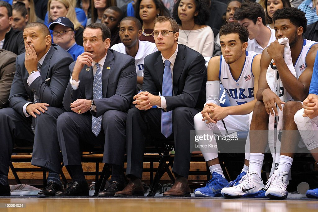 Associate Head Coach Jeff Capel, Head Coach <a gi-track='captionPersonalityLinkClicked' href=/galleries/search?phrase=Mike+Krzyzewski&family=editorial&specificpeople=213322 ng-click='$event.stopPropagation()'>Mike Krzyzewski</a>, Assistant Coach <a gi-track='captionPersonalityLinkClicked' href=/galleries/search?phrase=Jon+Scheyer&family=editorial&specificpeople=3847405 ng-click='$event.stopPropagation()'>Jon Scheyer</a>, <a gi-track='captionPersonalityLinkClicked' href=/galleries/search?phrase=Tyus+Jones&family=editorial&specificpeople=10012848 ng-click='$event.stopPropagation()'>Tyus Jones</a> #5 and <a gi-track='captionPersonalityLinkClicked' href=/galleries/search?phrase=Justise+Winslow&family=editorial&specificpeople=11268130 ng-click='$event.stopPropagation()'>Justise Winslow</a> #12 of the Duke Blue Devils look on from the bench during their game against the Elon Phoenix at Cameron Indoor Stadium on December 15, 2014 in Durham, North Carolina. Duke defeated Elon 75-62.