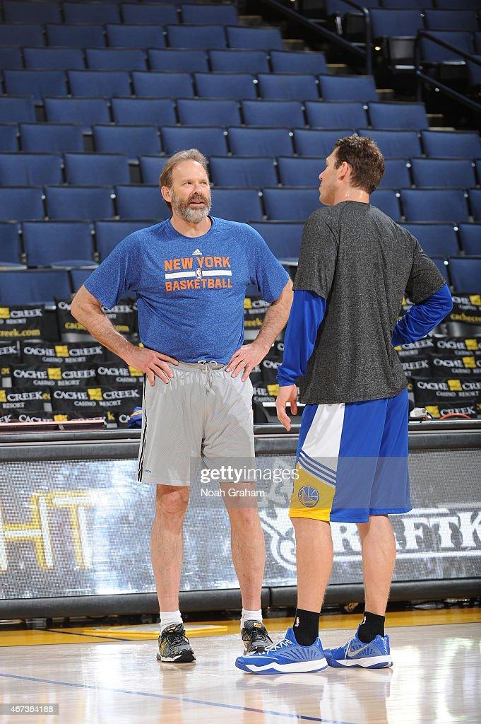 Associate Head Coach Kurt Rambis of the Golden State Warriors and assistant coach Luke Walton of the Golden State Warriors speak before a game on...