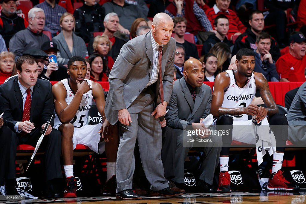 Associate head coach Larry Davis of the Cincinnati Bearcats looks on against the VCU Rams during the game at Fifth Third Arena on December 20 2014 in...