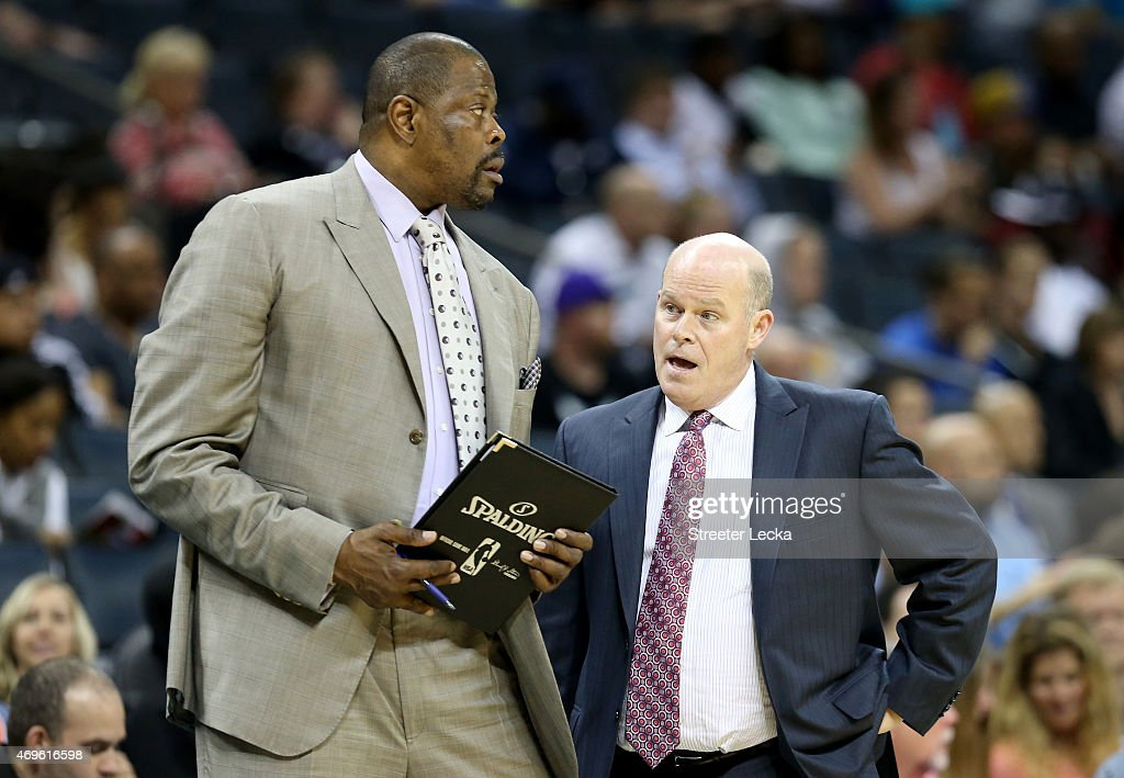 Associate head coach Patrick Ewing and head coach Steve Clifford of the Charlotte Hornets talk on the sidelines against the Houston Rockets during...