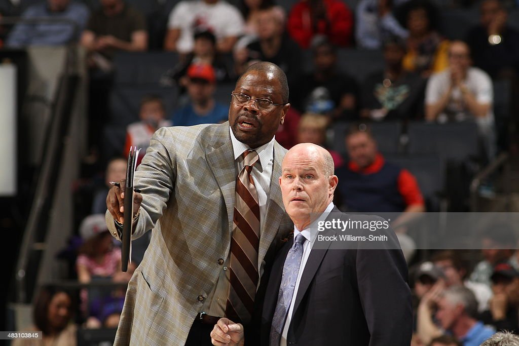 Associate Head Coach <a gi-track='captionPersonalityLinkClicked' href=/galleries/search?phrase=Patrick+Ewing&family=editorial&specificpeople=202881 ng-click='$event.stopPropagation()'>Patrick Ewing</a> and Head Coach Steve Clifford of the Charlotte Bobcats during a game against the Portland Trail Blazers during the game at the Time Warner Cable Arena on March 22, 2014 in Charlotte, North Carolina.