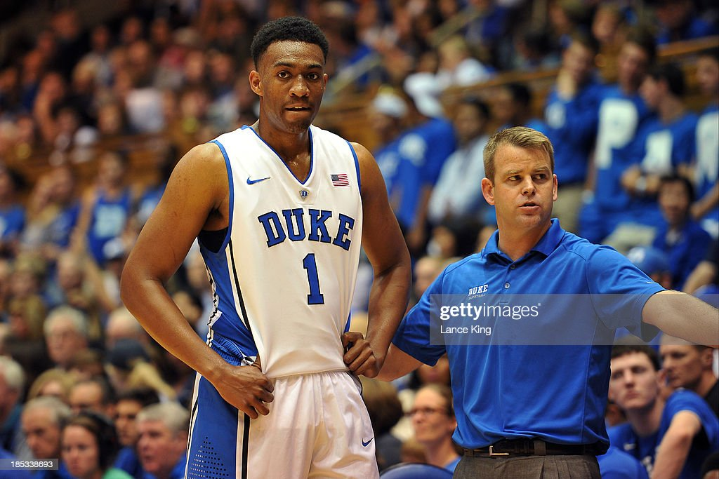 Associate Head Coach Steve Wojciechowski (R) talks with <a gi-track='captionPersonalityLinkClicked' href=/galleries/search?phrase=Jabari+Parker&family=editorial&specificpeople=9330340 ng-click='$event.stopPropagation()'>Jabari Parker</a> #1 of the Duke Blue Devils of the Duke Blue Devils during Countdown to Craziness at Cameron Indoor Stadium on October 18, 2013 in Durham, North Carolina.