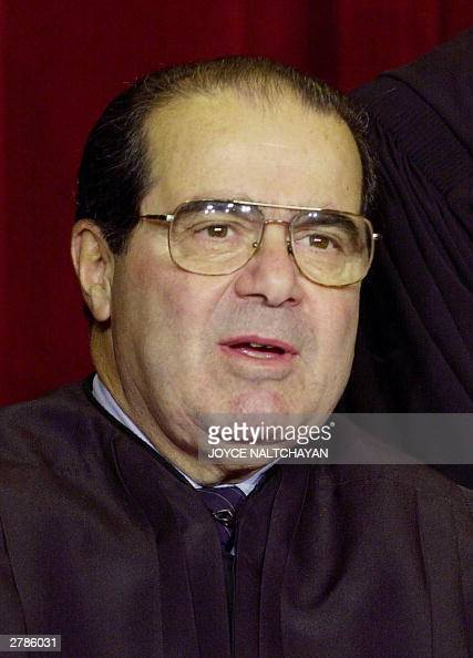 Associate Justice Antonin Scalia looks on as the the Supreme Court of the United States pose for an official photo 05 December 2003 at the Supreme...