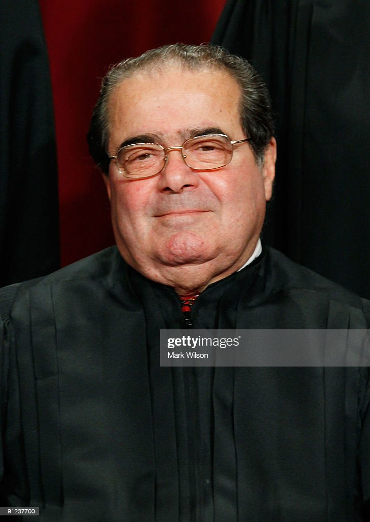 Associate Justice <a gi-track='captionPersonalityLinkClicked' href=/galleries/search?phrase=Antonin+Scalia&family=editorial&specificpeople=215620 ng-click='$event.stopPropagation()'>Antonin Scalia</a> poses during a group photograph at the Supreme Court building on September 29, 2009 in Washington, DC. The high court made a group photograph with its newest member Associate Justice Sonia Sotomayor.