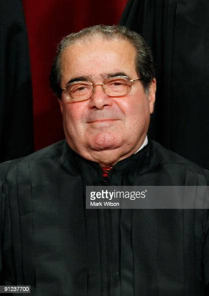 Associate Justice Antonin Scalia poses during a group photograph at the Supreme Court building on September 29 2009 in Washington DC The high court...