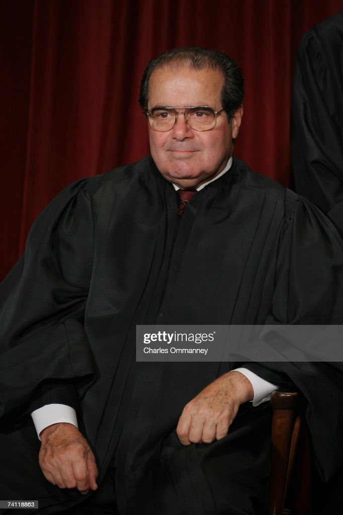 Associate Justice <a gi-track='captionPersonalityLinkClicked' href=/galleries/search?phrase=Antonin+Scalia&family=editorial&specificpeople=215620 ng-click='$event.stopPropagation()'>Antonin Scalia</a> poses for photographers at the U.S. Supreme Court October 31, 2005 in Washington DC. Earlier in the day U.S. President George W. Bush nominated judge Samuel Alito to replace Sandra Day O'Connor who is retiring once her replacement is confirmed by the Senate.