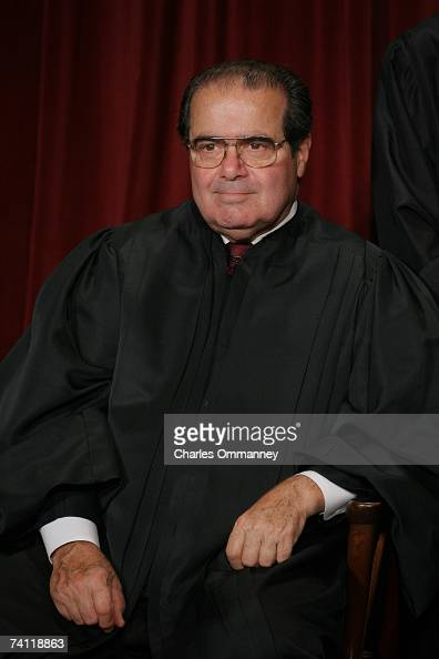 Associate Justice Antonin Scalia poses for photographers at the US Supreme Court October 31 2005 in Washington DC Earlier in the day US President...