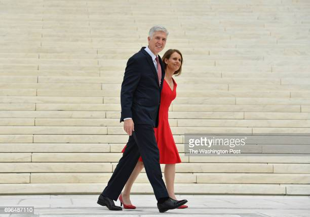 Associate Justice Neil M Gorsuch walks away with his wife Louise at the US Supreme Court following an investiture ceremony on June 15 2017 in...