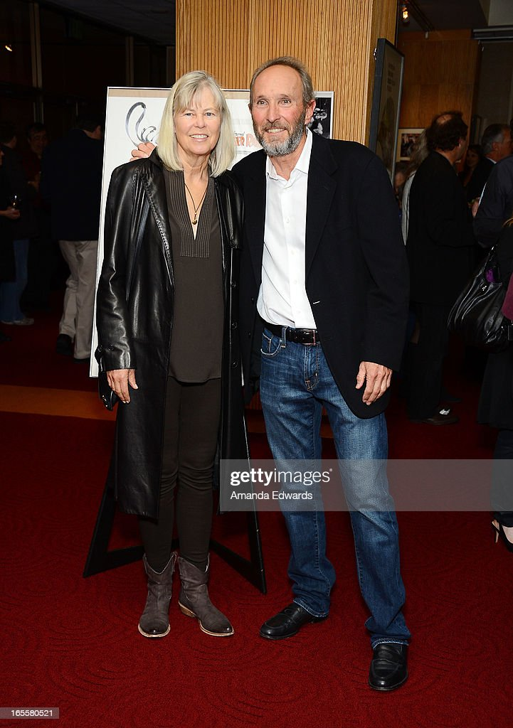 Associate producer Steve Starkey (R) and his wife Olivia Erschen arrive at The Academy Of Motion Picture Arts And Sciences' 25th Anniversary Screening Of 'Who Framed Roger Rabbit' at AMPAS Samuel Goldwyn Theater on April 4, 2013 in Beverly Hills, California.