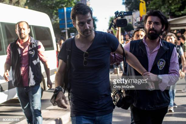 Associated Press videographer Bram Janssen of the Netherlands is arrested by police while covering the LGBT Pride March on June 25 2017 in Istanbul...