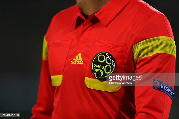 ZNSS Association Football Referee Slovenia badge on a red adidas referee shirt with a respect badge
