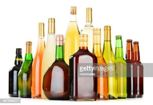 Assorted Alcohol Bottles Against White Background Stock ...