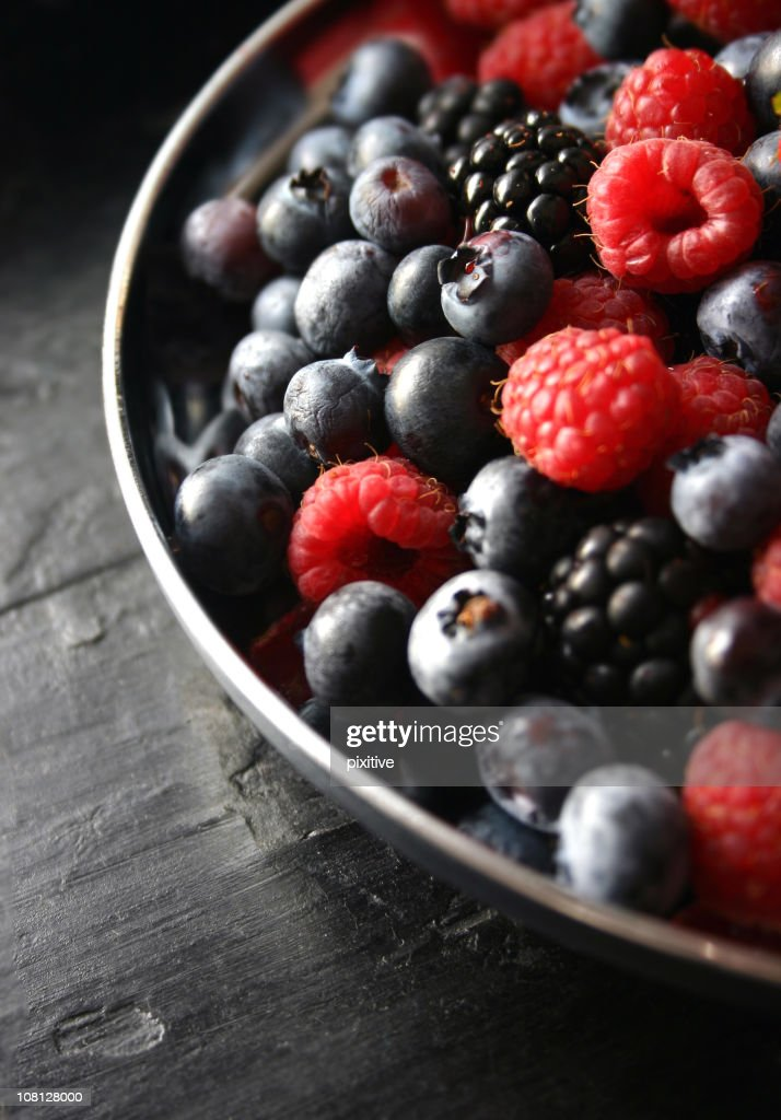 Assorted Berries in Bowl on Table : Stock Photo