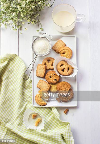 Assorted butter cookies with icing sugar.
