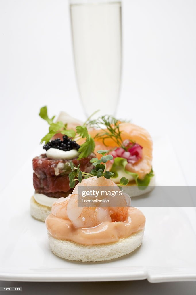 Assorted canape and glass of sparkling wine closeup stock for Types of canape bases