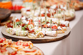 Assorted canape with cheese, meat, rolls, bakery and vegetables. Food to accompany the drinks. the buffet at the Banquet. A reason to celebrate the event. Wedding or anniversary