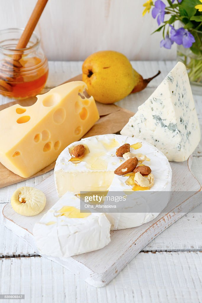 Assorted cheese on a cutting board : Stock Photo