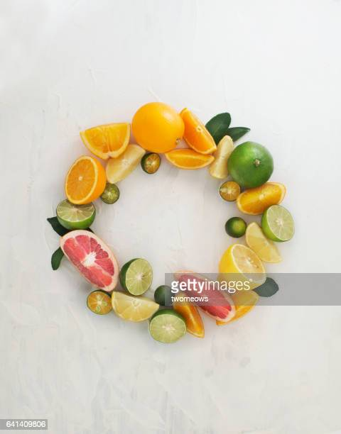 Assorted citrus fruits shaped in a circle form.