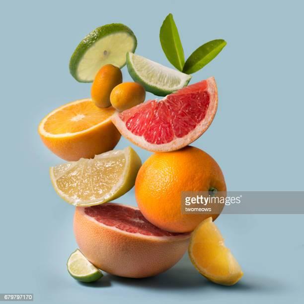 Assorted citrus fruits stack still life.