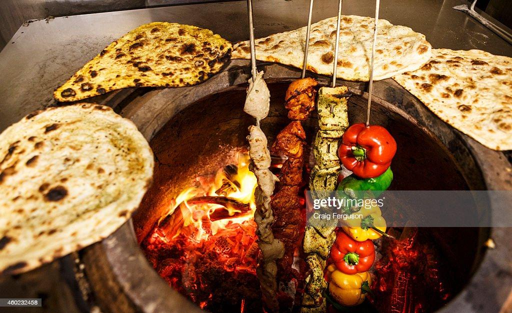 Assorted food in a tandoor oven in an Indian restaurant