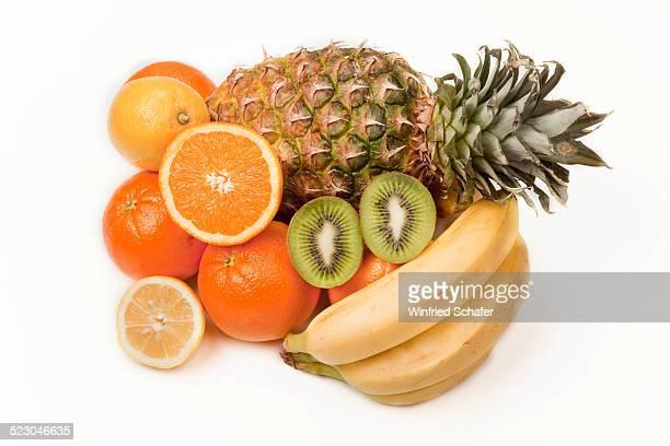 Assorted fruit, pineapple, kiwi fruit, oranges, lemon