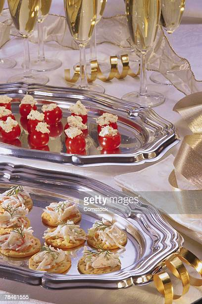 Assorted Hors hors d oeuvres on silver trays