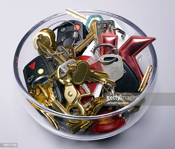 Assorted keys in glass bowl