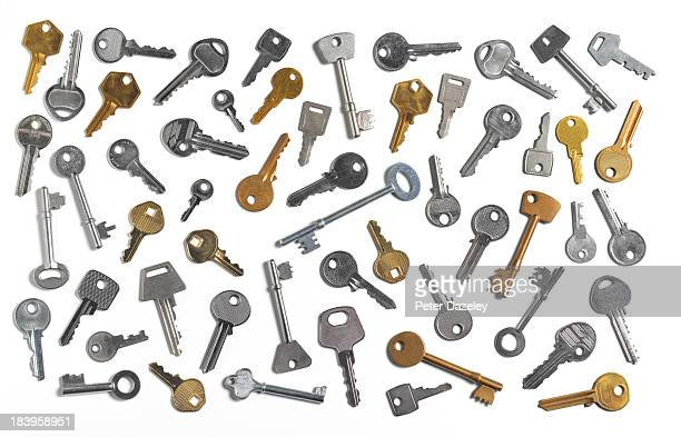 Assorted keys on white background