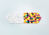 Assorted medical pills and tablets in shape of drug capsule