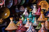 Assorted Moroccan tajines in a souk