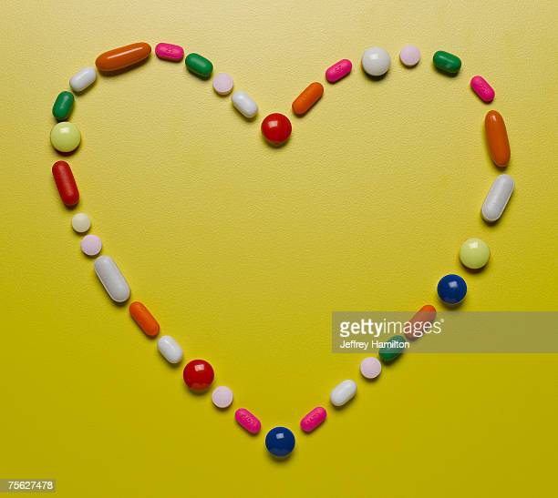 Assorted pills creating heart shape