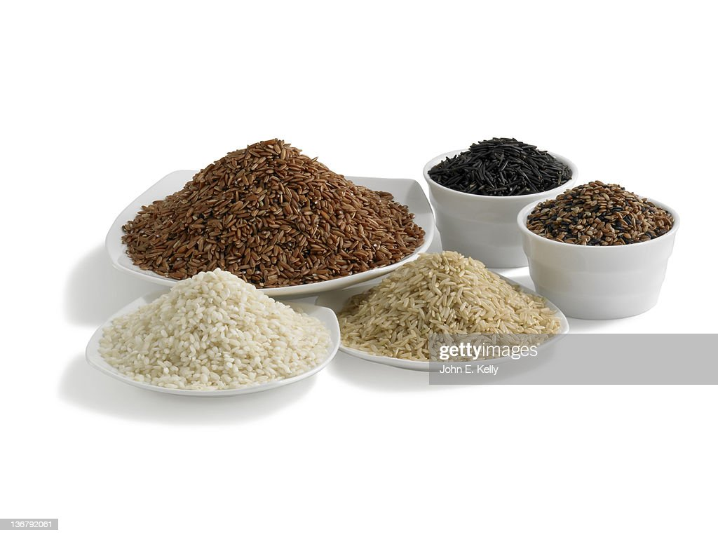 Assorted rice on white : Stock Photo