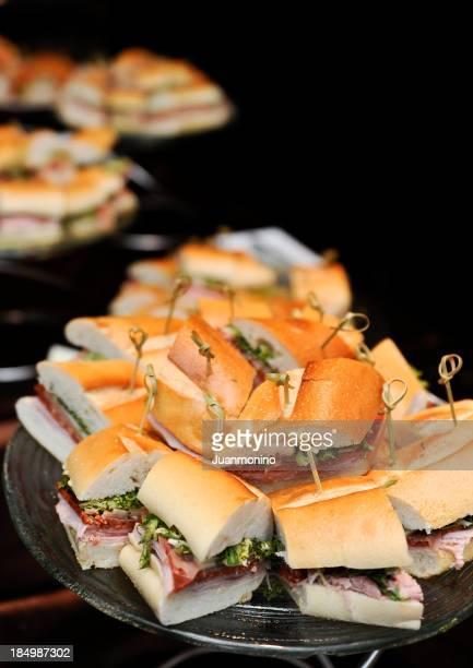 Assorted stacks of sandwiches against black background