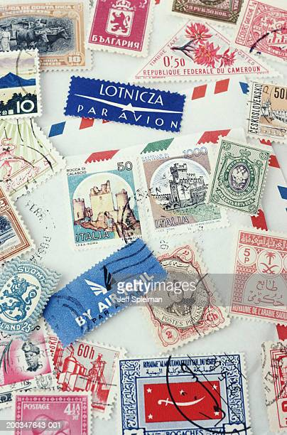 Assorted stamps from various countries, overhead view