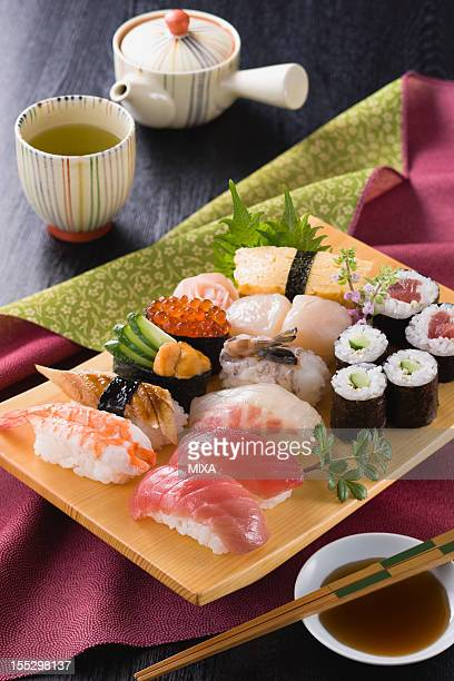 Assorted Sushi on Wooden Plate