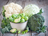 Assortment of cabbages on old wood background