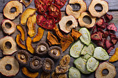 An assortment of organic dried fruits and vegetables prepared for cooking.