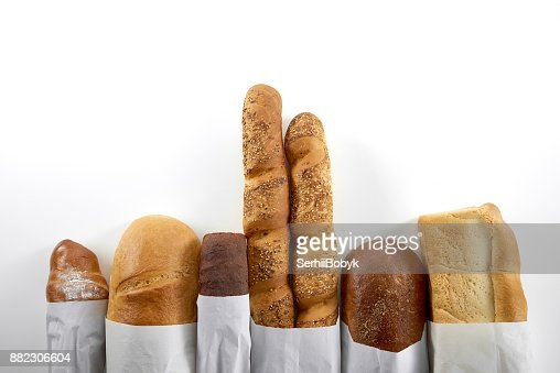 Assortment of fresh bread isolated on white : Stock Photo
