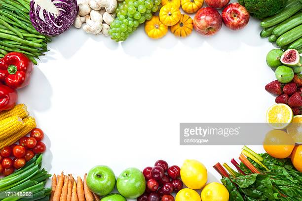 Assortment of fruits and vegetables disposed on a frame shape