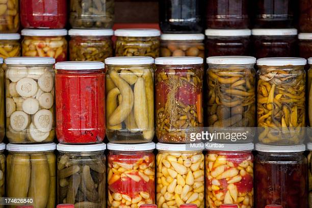 Assortment of glass jars filled with pickled vegetables