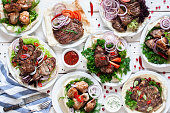 Assortment of grilled meat meals flat lay. Top view on restaurant table with variety of barbecue snacks. Restaurant menu, delicious food, dieting, gourmet concept