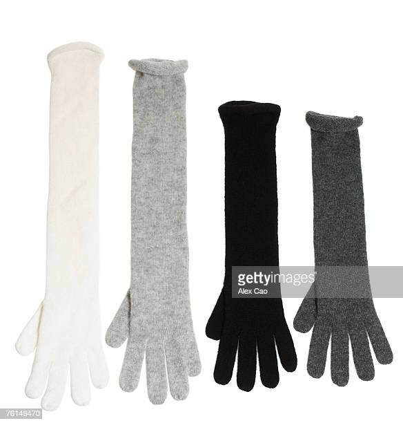 Assortment of long knit gloves in black, white, light and dark grey