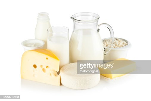 Assortment of most common dairy products on white backdrop