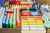 Assortment of multicolored thread spools for sewing