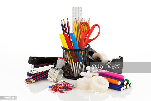 Assortment of office supplies on white backdrop