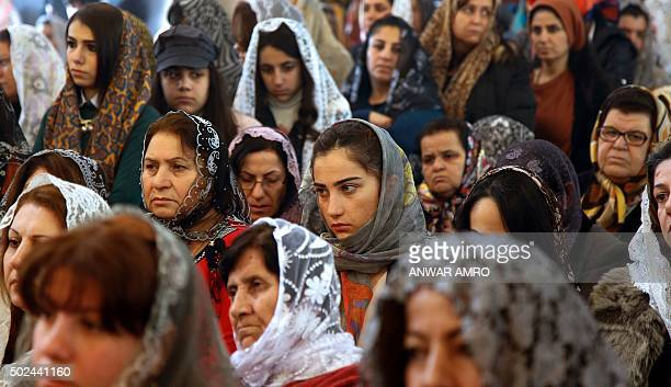 Assyrian Christians from Syria and Iraq attend a Christmas mass at Saint Georges church in an eastern suburb of the Lebanese capital Beirut on...